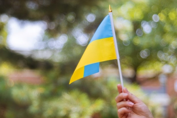 Female Hand with Ukraine National Flag - Happy Ukraine Independence Day